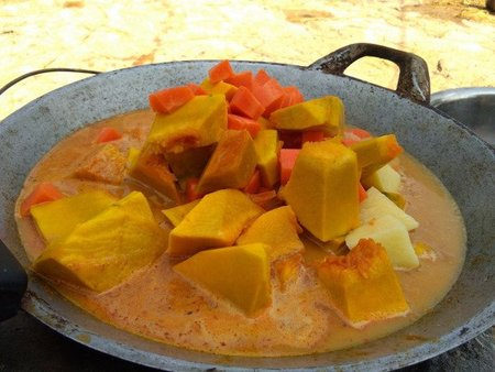 Nice vegan pumpkin curry in a old style Thai wok.