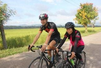 Cycling together in Thailand - Lek & Greg Vegan Camp